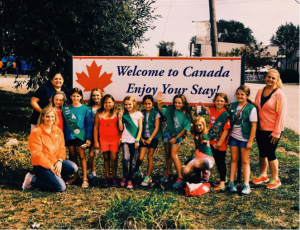 Scouts are International Travelers. Troop in front of the Welcome to Canada sign