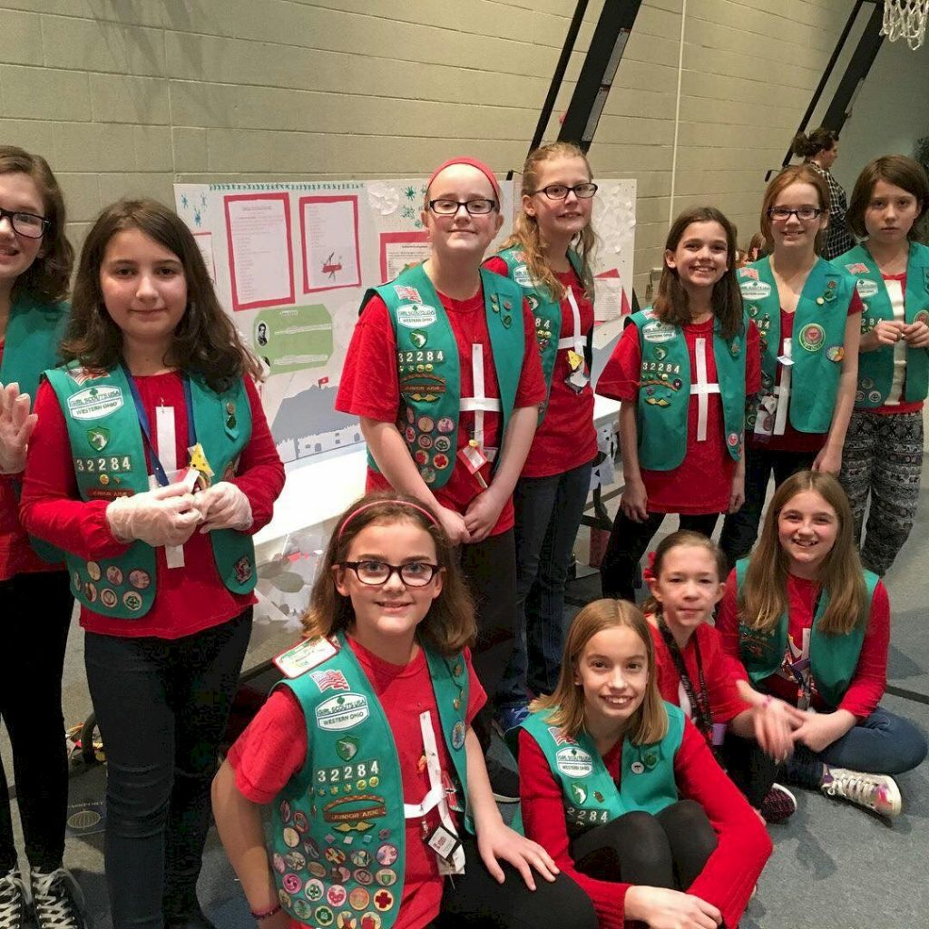 Junior Girl Scouts Represent Switzerland for Thinking Day.