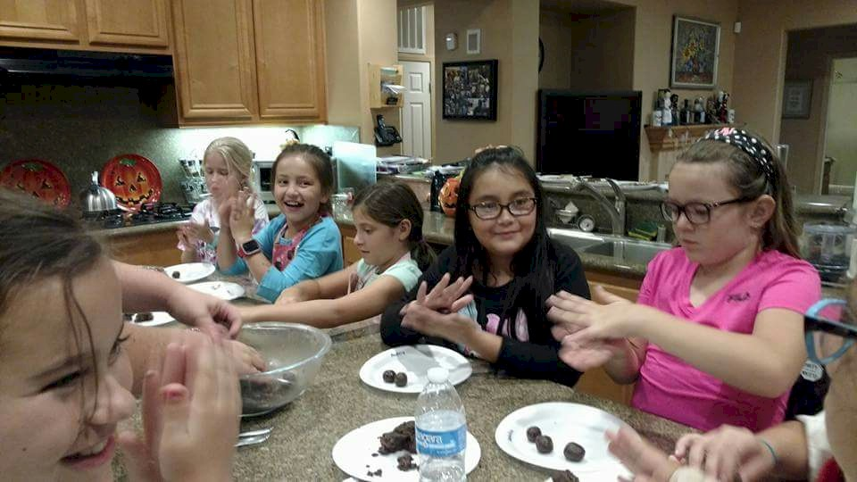Junior Girl Scouts Earning Chocolate Patch