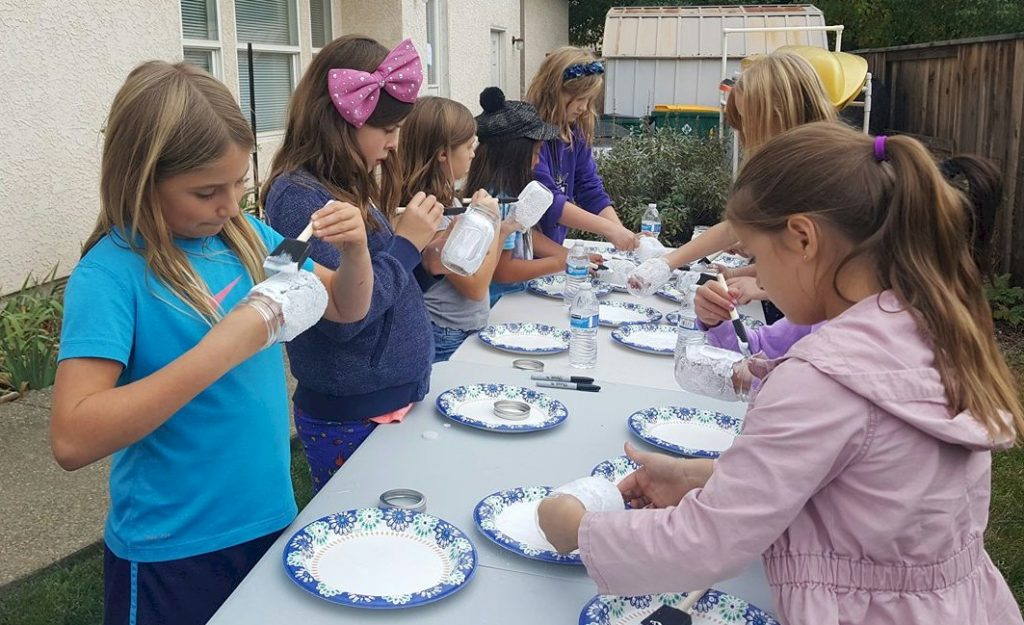 Junior Girl Scouts Making Crafts