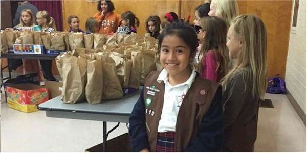 Brownie Girl Scouts making a difference in the community.