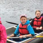 Cindy Smith's Cadette troop in a canoe while camping.
