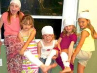Daisy Troop 74909 of Davenport Florida learns first aid so they can act responsibly when someone is injured.
