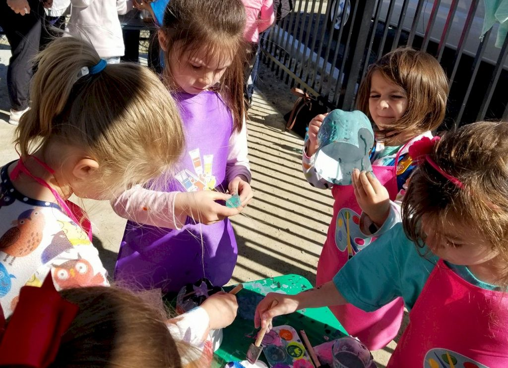 Daisy Girl Scouts Making Bird Feeders from Recycled Materials.