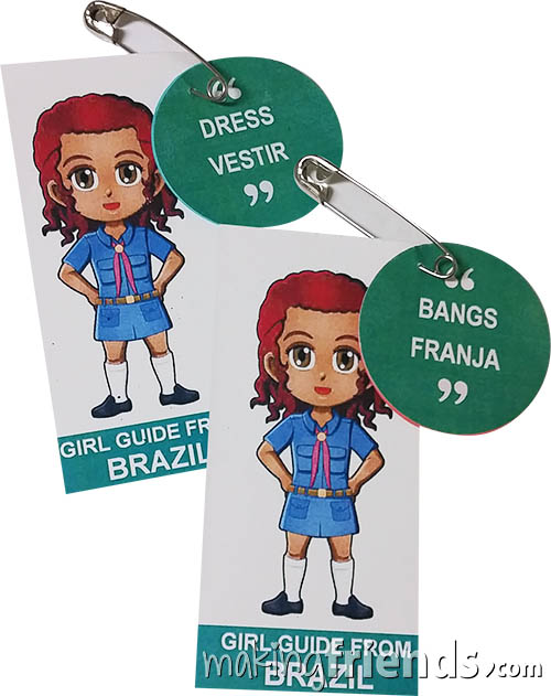 Brazil International Friendship Swap Kit: Learn Portuguese. Superhero Prudence wears a Girl Guide uniform from Brazil for these Thinking Day* crafts. Learn 30 different Portuguese words while you make these pins for swapping. No scissors or glue needed. Kit makes 30. Available at MakingFriends®.com. Information about Brazil, patches, crafts, passports and more for your international event on our pageBrazil| Ideas for Thinking Day*. #thinkingday #swaps #scouts #makingfriends via @gsleader411