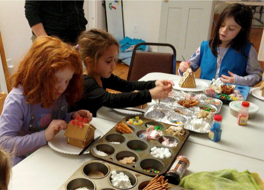 Daisy Girl Scouts making Gingerbread Houses