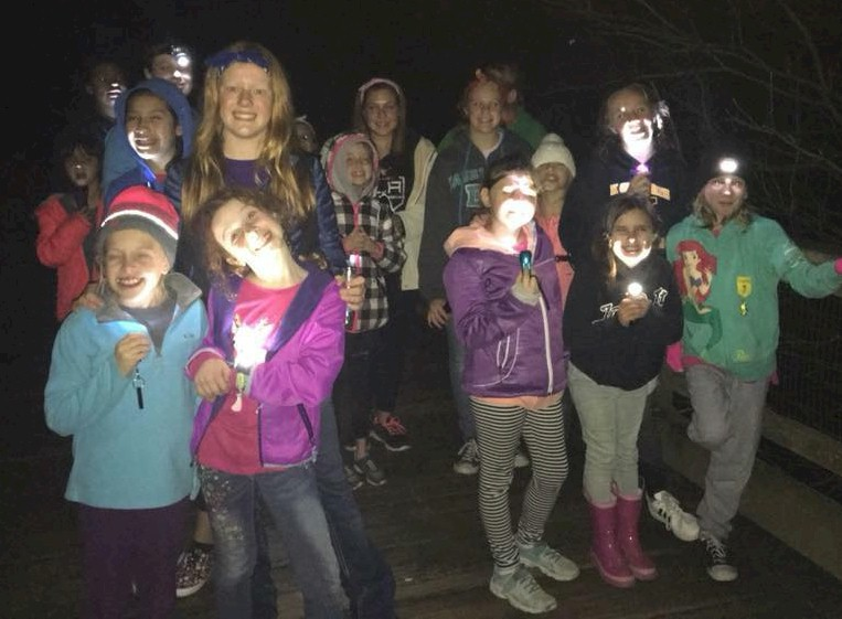 Brownie Girl Scouts Go On a Night Hike.