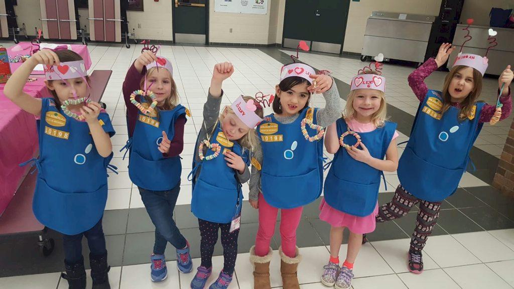 Daisy Girl Scouts making bird treats.