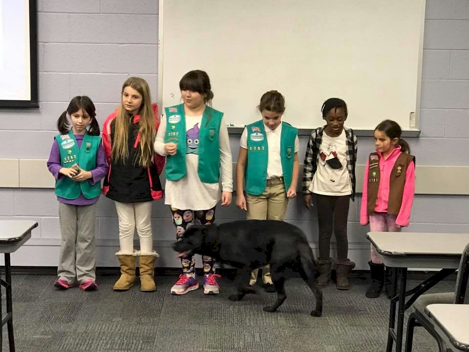 Girl Scouts get a visit from a service dog.