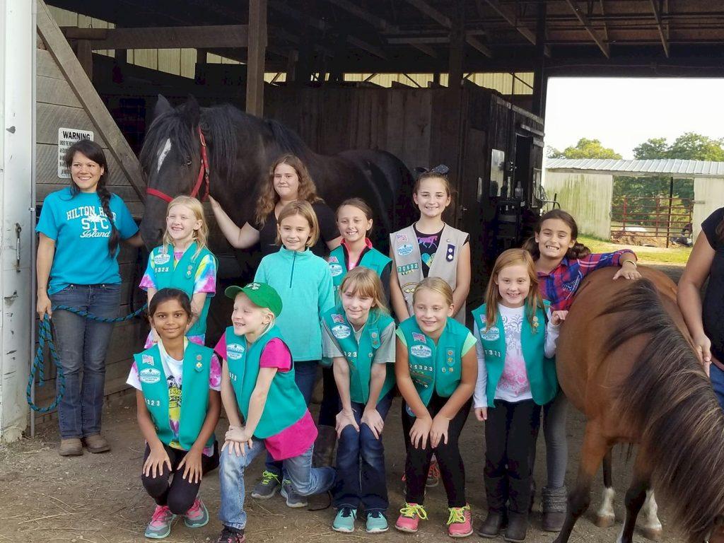 Junior Girls Scouts horseback riding.