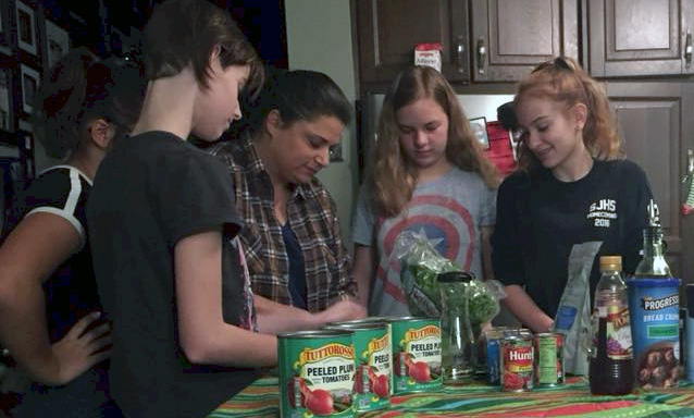 Junior Girl Scouts Making a Spaghetti Dinner