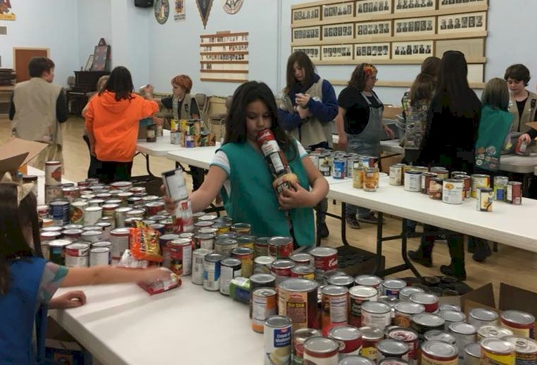 Girl Scouts sorting food for the food bank.