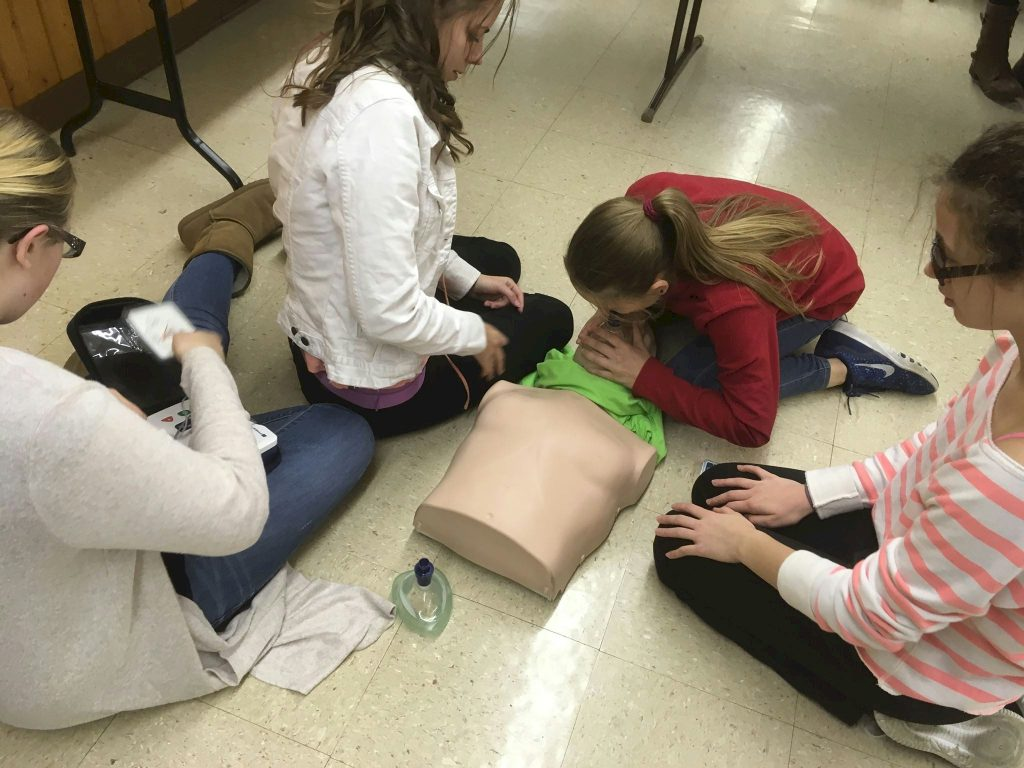 Girl Scouts learning CPR