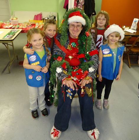 Girl Scout decorate leader at Christmas party