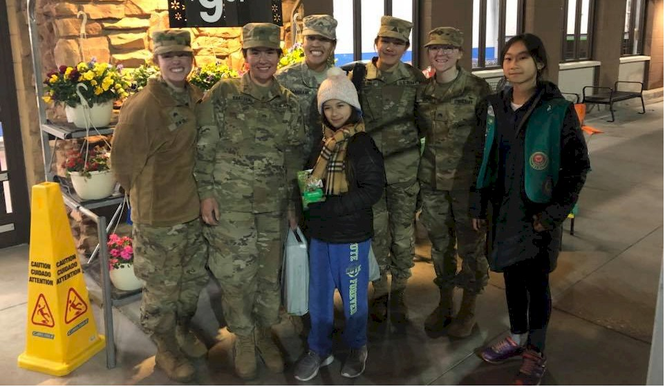 Junior Girl Scouts Give Cookies to Women in the Military.