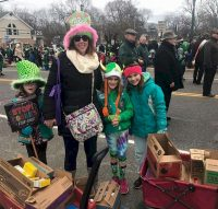 Here's a great way to earn a St. Patrick's Day patch. Junior Troop 806, Islip Terrace NY, having a walkabout sale during the East Islip St Patrick's Day parade. The girls were selling cookies over the sounds of bagpipe bands and fire department trucks and braving the cold to walk a mile and half in each direction to sell as many boxes as they could before the parade ended.