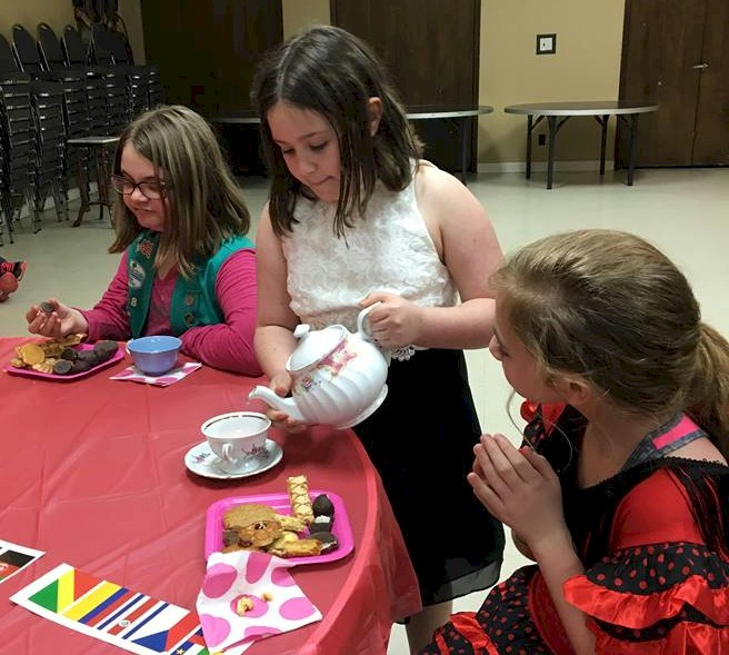Girl Scouts having a tea party.