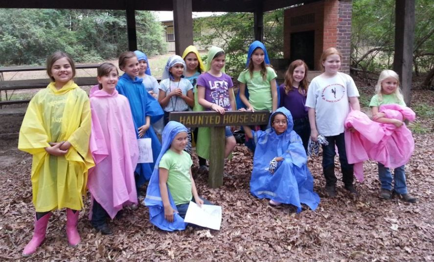 Girl Scouts camping in the rain.