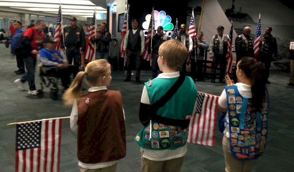 Girl Scouts attend an Honor Flight.