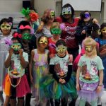 Girl Scouts at a masquerade ball.