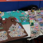 Vests displayed at Girl Scout Birthday event hosted by Troop 418