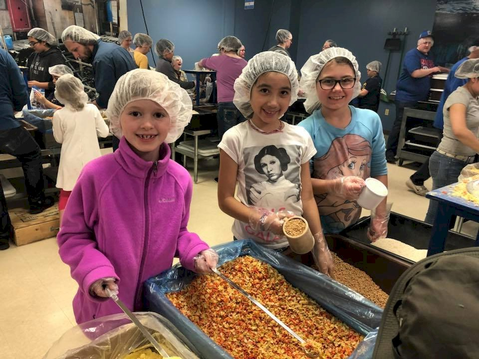 Brownie Girl Scouts Preaparing Meals for Children in Kenya.