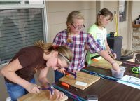Cadette Troop#1147 & #1121 working on their woodworking badge.