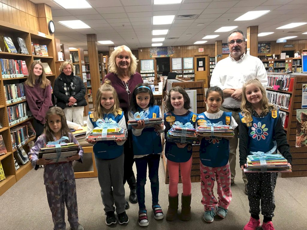 Daisy Girl Scout's Delivery Book from Their Book Drive.