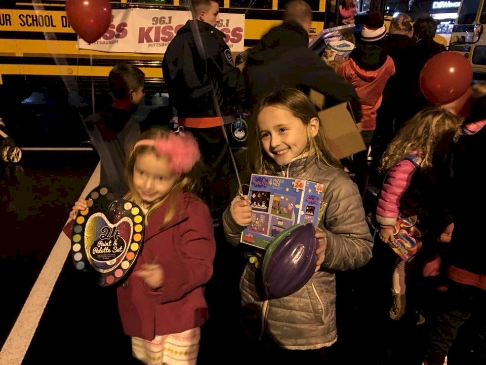 Daisy Girl Scout troop Delivering toys for Toys