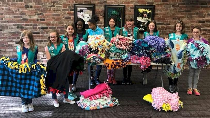 Juniors making no-sew fleece blankets to donate.