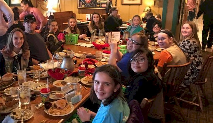 Girl Scouts enjoying a meal after touring the reastaurant.