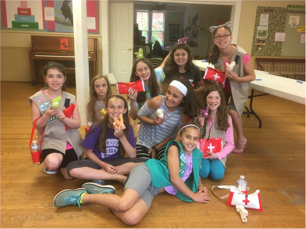 Girl Scout Cadettes completing First Aid Badge in a Bag from MakingFriends.com