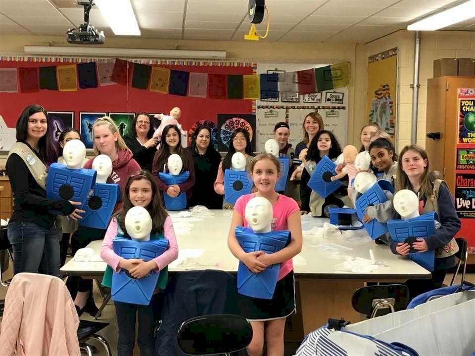 Girls Scouts learning CPR