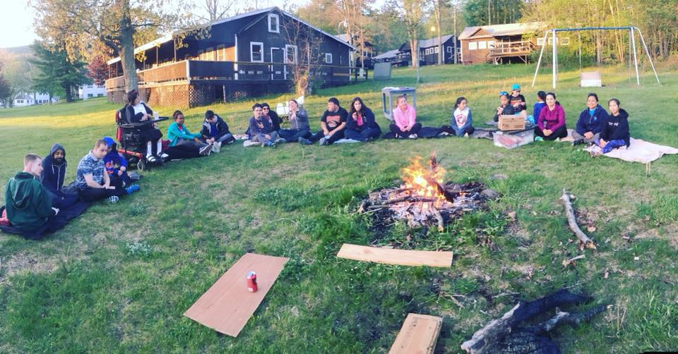 Girl Scouts enjoying a campfire.