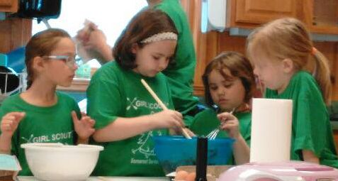 Daisy Girl Scouts Making Cup Cakes