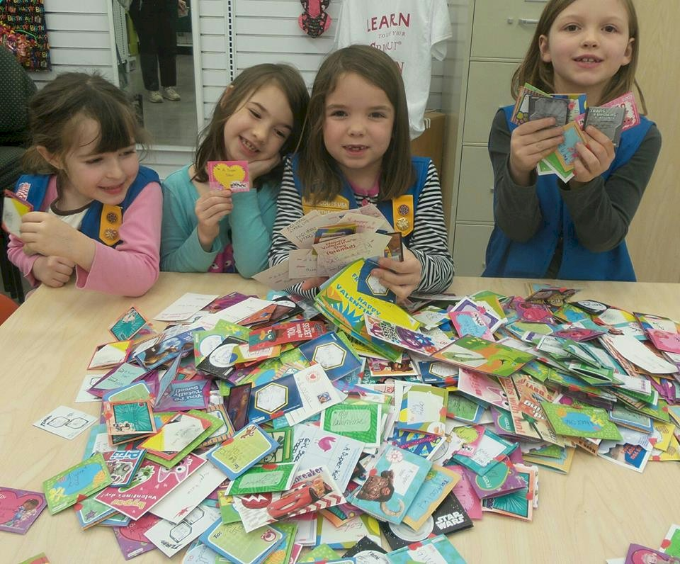 Daisy Girl Scouts Signing Valentine Cards.