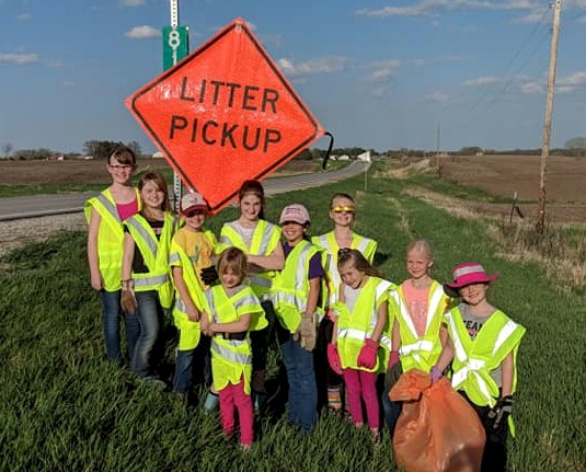 Girl Scouts doing a highway cleanup.