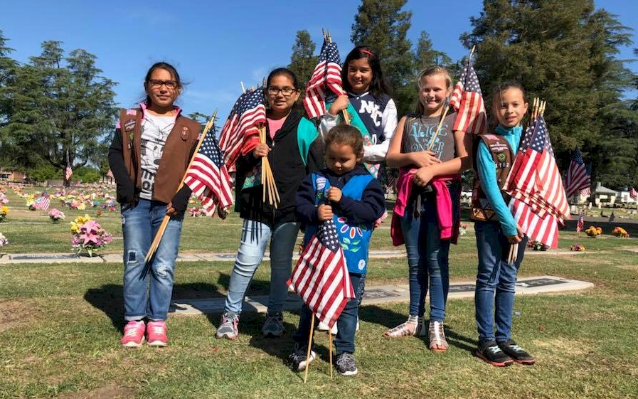 Girl Scout flag placement for our fallen military heroes.