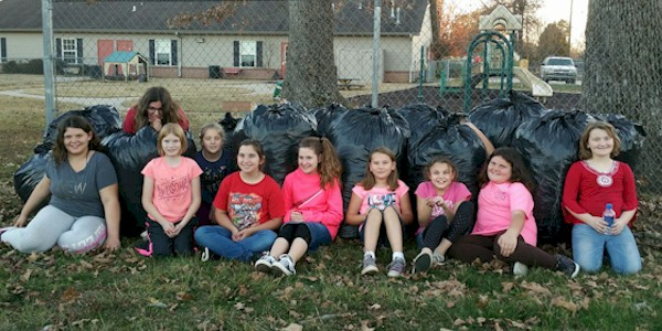 Brownie Girl Scouts Doing Community Service