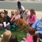 Brownie Girl Scouts with Rescue Dog