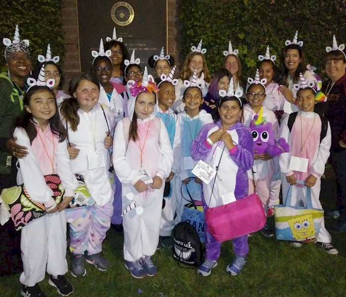 Cadette Girl Scouts Earning Their Night Owl Badge