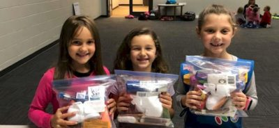 Daisy Girl Scout with their Blessings Bags.