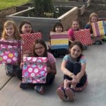 Junior Girl Scouts earning their Girl Scout Ways Badge