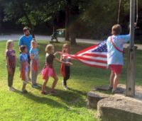 Junior Troop 14661 - Flag raising at Singing Hills.