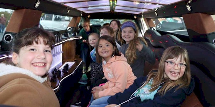 Girl Scouts in a Limousine
